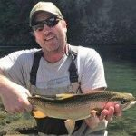 Pete Bevan UK with Taupo Rainbow trout caught fly fishing with Taupo fishing guides NZFC