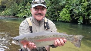 Steve with Taupo backcountry rainbow trout caught with best fly fishing guides