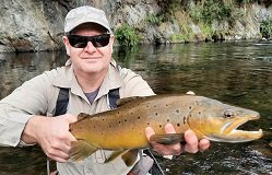 Fly fishing guide Chris Power with a wild brown trout