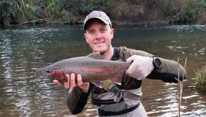 Nick holding rainbow trout caught with NZFC Taupo Fly Fishing Guides